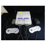 Super Nintendo with controllers power cord & TV