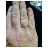 Nice gold colored and clear stone ring approx