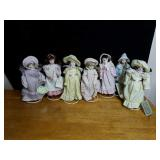 Collection of 7 little porcelain dolls approx 8