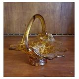 Unusual amber colored basket with circle pattern