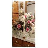Big white wicker basket of flowers