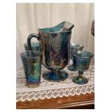 Carnival glass pitcher with 2 stems and 2 glasses