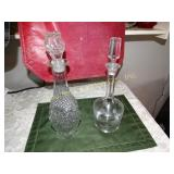 2 Glass decanters  (1 with etched glass) tallest