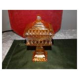 Orange carnival glass square pedestal lidded