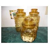 3 Amber glass canisters tallest 9""