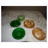 2 Green glass saucers, green glass tea cup, 2