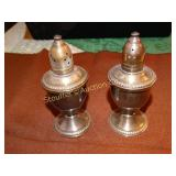 Sterling silver weighted salt and pepper shakers,