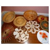 Assorted trivets and wicker basket