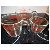 3 Pyrex measuring cups largest is 4 cups