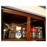 Assorted jars and canning lids, contents of shelf