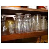 Assorted glass ware, contents  of bottom shelf