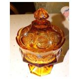 "Lidded pedestal coin candy dish, amber glass 8""t"
