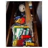 contents of drawer, lighters, knife sharpener,