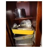 baking pans, sifter, contents of cabinet