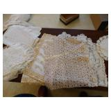 Assorted lace and crochet runners, doiles