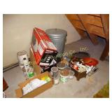 Contents beneath basement stairs:  galv. trash