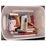Rubbermaid containing with assorted books on