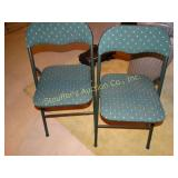 2 Green fabric folding chairs