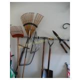 Rack of long handle tools & hand saws & pruner