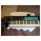 Casio CA-100 Elect. Keyboard w/head set & adapter