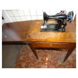 Singer Sewing Machine in cabinet w/foot pedal
