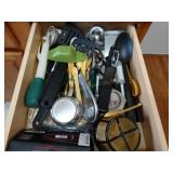 Contents of drawer, assorted utensils, measuring