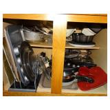 Bottom cupboard, pots and pans, baking pans,