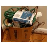 Box of extension cords, one 9ft NIP