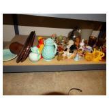 Contents of bottom shelf, knick knacks, pitcher,