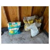Landscaping stones and used bag of grass seed