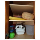contents of corner cabinet, plastic ware, timer,