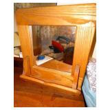 "Oak framed wall mounted mirror, 19""w x 19""h"