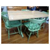 Table and 4 chairs with seat cushions, some