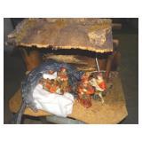 Nativity scene with ceramic figures marked house