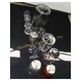 "Glass canisters (tallest 9""), glasses, candles,"