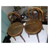 2 Antique round seat wooden chairs