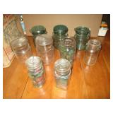 White And Green Glass Jars With Glass Lids