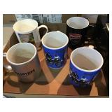 Lot of five collector coffee mugs  including