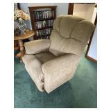 Upholstered beige swivel recliner
