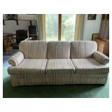 Three cushion upholstered sofa and chair