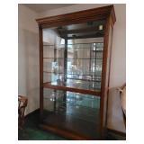 Howard Miller oak showcase display case