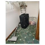 Vacuum, fan, suitcase, bedding, etc