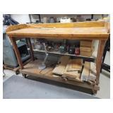 Wooden workbench on wheels