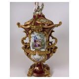 Ornate hand painted porcelain lidded urn