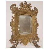 Ornate bronze dresser mirror with Putti