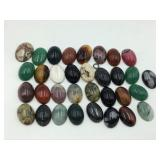 Grouping of unset cabochon stones