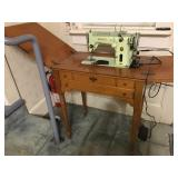 Singer Sewing Machine in Maple Cabinet