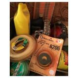 Box Lot  gas can, string trimmer line, wheels etc