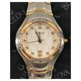 Gorgeous diamond accented ladies watch marked