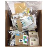 Large box of stamp collection items